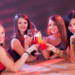 Female friends enjoying a cocktail — Stock Photo