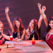 Young women celebrating in a nightclub — Foto Stock