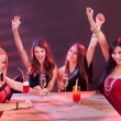 Young women celebrating in a nightclub — Stock Photo #13652432