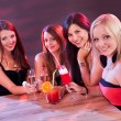 Female friends enjoying a night out - Stock Photo