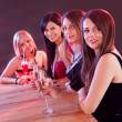 Stock Photo: Young ladies at a bar counter