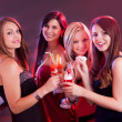 Happy female friends celebrating — Stock Photo