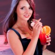 Glamorous woman holding a cocktail - Stock Photo