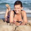 Beautiful young woman relaxing at the beach — Stock Photo