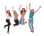Mujer joven cuatro saltos de alegría — Foto de Stock