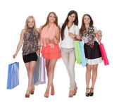 Four happy women returning from shopping — Stock Photo