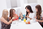 Women discussing footwear together — Stock Photo