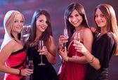 Stylish women toasting with champagne — Stock Photo