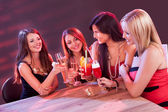 Female friends enjoying a night out — Stock Photo