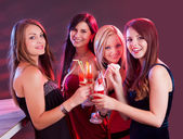 Happy female friends celebrating — Stock Photo