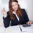 Smiling accountant sitting at her desk working — Stock Photo