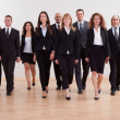 Group of business executives approaching - Stok fotoğraf