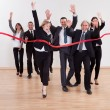 Jubilant business celebrating - Stock Photo