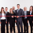 Stock Photo: Management about to cut red ribbon