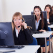 Telephonists in a call centre — Stock Photo #15334787