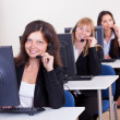 Stock Photo: Telephonists in a call centre