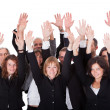 Group of business waving in acknowledgment — Stock Photo #15334851
