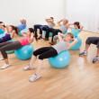 Class of diverse doing pilates — Stock Photo
