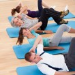 Stock Photo: Group of exercising in gym class