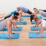 Gym class doing press ups — Stock Photo