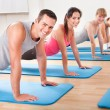 Gym class doing press ups - Stockfoto