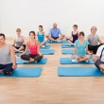 Group of practicing yoga meditating — Stock Photo