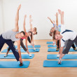 pilates class exercising in a gym — Stock Photo