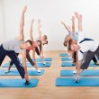 Royalty-Free Stock Photo: Pilates class exercising in a gym