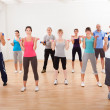 Aerobics class working out with dumbbells — Stock Photo #15335173