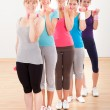 Stock Photo: Aerobics class working out with dumbbells