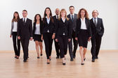 Group of business executives approaching — Stock Photo