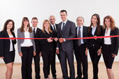 Management about to cut the red ribbon — Stock Photo