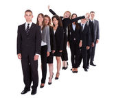 Businesswoman standing out from the crowd — Stock Photo