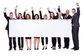 Group of business with a blank banner — Stock Photo
