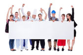 Group of diverse professional with a banner — Stock Photo