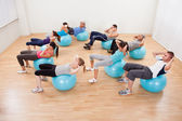 Class of diverse doing pilates — Stock Photo