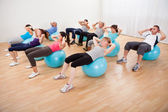 Class of diverse doing pilates — Stockfoto