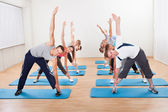 Pilates class exercising in a gym — Foto Stock