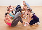 Happy working out in a gym — Stock Photo