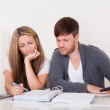 Unhappy young couple in financial trouble — Stock Photo