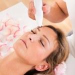 Attractive woman undergoes facial treatment — Stock Photo
