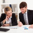 Business partners discuss sales - Foto de Stock