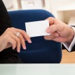 Man handing over a business card — Stock Photo