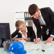 Construction plans revised and signed - Stock Photo