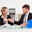 Stock Photo: Architects shaking hands in the office