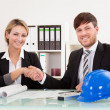 Architects shaking hands in the office — Stock Photo #15717607