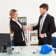 Architects shaking hands in the office — Stock Photo #15717639
