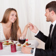 Loving couple enjoying a romantic meal — Stock Photo