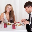 Young couple enjoying a romantic dinner — Stock Photo