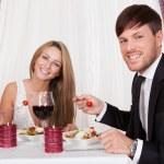 Young couple enjoying a romantic dinner — Stock Photo